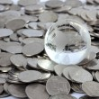 Stock Photo: Globe on coins money, Money is God Concept.
