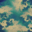 Grunge heart clouds on the sky old paper background — Stock Photo