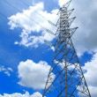 Stock Photo: High-voltage towers under blue sky.