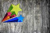 Barevné hvězdy na zdi grunge — Stock fotografie