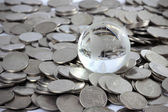 Globe on coins money, Money is God Concept. — Stock Photo