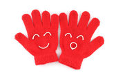 Pair of red winter gloves with happy face — Stock Photo