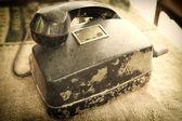 Retro rotary telephone on natural linen texture — Stock Photo