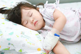 Little girl sick on the sick bed — Stock Photo