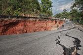 Beneath the asphalt. Layer of soil beneath the asphalt road. — Stock Photo