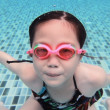 Little asian girl underwater in swimming pool — Stock Photo #49230503