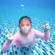 Little asian girl underwater in swimming pool — Stock Photo #49230793
