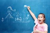Girl drawing my family on chalkboard — Stock Photo