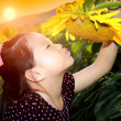Cute asian child with sunflower — Stock Photo #49240333