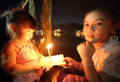 Little girl in Loy Kratong festival, chiang mai thailand — Stock Photo