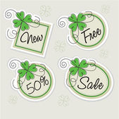 Label set with clovers — Stockvector
