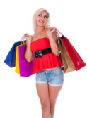 Sexy shopping girl isolated on white — Stock Photo