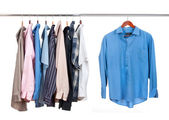 Clothes hanger with shirts on white — Stock Photo