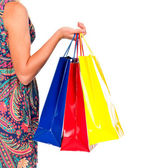 Shopping bags set in woman's hand isolated on white — Foto Stock