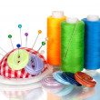 Bright sewing buttons, needle and skeins of thread isolated on white — Stock Photo