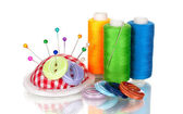 Bright sewing buttons, needle and skeins of thread isolated on white — Foto Stock