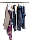 Fashion colorful clothing hanging a on display — Stock Photo