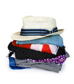 Pile of colorful clothes with a hat over white background — Stockfoto