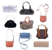 Set of multicolored female bags on a white background — Foto Stock