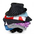 Pile of colorful clothes with hat over white background — Stock Photo #13155168