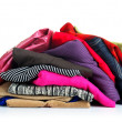 Stock Photo: Big heap of colorful clothes, view from above, isolated on white background.