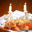 Sabbath image. challah bread and candelas on wooden table — Stock Photo