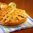 Homemade apple pie on wooden table — Stock Photo