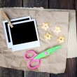 Set of photo frame scissors and crumpled paper on wooden background — Stock Photo
