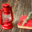Vintage red lantern and red book on wooden table — Stock Photo #29275089