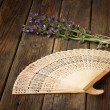 Wooden folding fan on wood table — Stock Photo