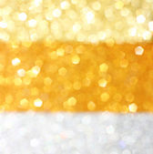 Gold and silver defocused glitter lights background. abstract bokeh. — Stok fotoğraf