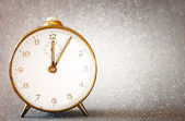 Vintage clock with glittering silver background — Stok fotoğraf