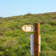 Sign post on green meadow — Stock Photo