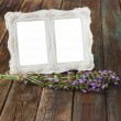 White vintage frame on wooden table — Stock Photo #29284419