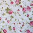 Fragment of colorful retro tapestry textile pattern with floral ornament useful as background — Stock Photo #29284489