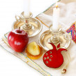 Stock Photo: Jewish New Year - Rosh Hashanah , apple with honey and candles isolated