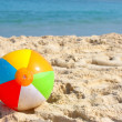 Day at the beach with a beach ball in the foreground. — Stock Photo