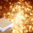 Christmas gift box on background of defocused golden lights. — Stok fotoğraf