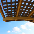 Close-up of a wooden garden pergola with  blue sky in the background — Stock Photo