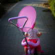 Lost and alone toddler sitting on bicycle, back view — Stock Photo