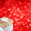 Stock Photo: Gift box on red background. copy space for text