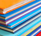 Close up of stack of colorful books — Stockfoto