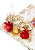 Jewish New Year - Rosh Hashanah , apple with honey and candles isolated — Stock Photo