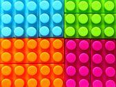 Kleurrijke geometrische achtergrond van bakstenen gebouw — Stockfoto
