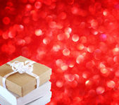Gift box on red background. copy space for text — 图库照片