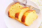 Fresh sliced lemon cake — Stock Photo