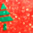 Christmas tree with defocused lights. Red background — Stock Photo #29292217