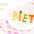 Plate with word diet composed of slices of different vegetables — Stock Photo #29292533