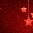 Red defocused background with bokeh lights and twinkling stars — Stockfoto