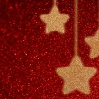 Red defocused background with bokeh lights and twinkling stars — Stock Photo